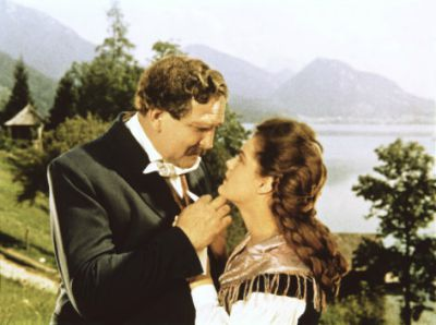 Gustav Knut and Romy Schneider as Sissi and her father in the film. On the background is lake Fuschl, acting as Lake Starnberg in Bavaria.